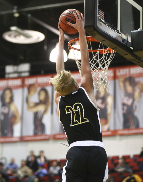 Clark guard Trey Woodbury (22) dunks against Coronado during the Class 4A boys state basketball semifinals at the Cox Pavilion in Las Vegas on Thursday, Feb. 23, 2017. Clark won 56-48. (Chase Stev ...
