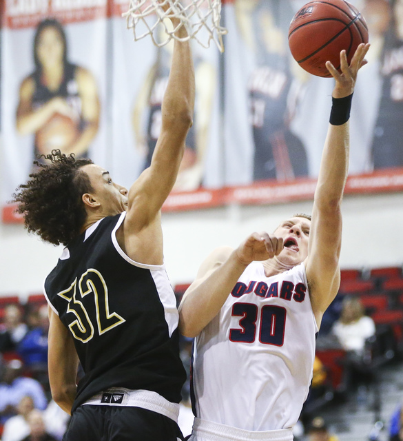 Coronado's Kennedy Koehler (30) shoots against Clark forward Ian Alexander (32) during the Class 4A boys state basketball semifinals at the Cox Pavilion in Las Vegas on Thursday, Feb. 23, 2017. Cl ...