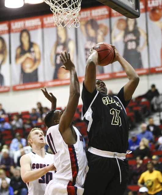 Clark forward Antwon Jackson (23) gets a rebound over Coronado during the Class 4A boys state basketball semifinals at the Cox Pavilion in Las Vegas on Thursday, Feb. 23, 2017. Clark won 56-48. (C ...