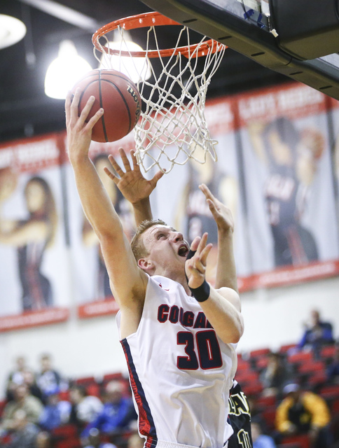 Coronado's Kennedy Koehler (30) shoots against Clark during the Class 4A boys state basketball semifinals at the Cox Pavilion in Las Vegas on Thursday, Feb. 23, 2017. Clark won 56-48. (Chase Steve ...
