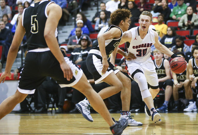 Coronado's Kennedy Koehler (30) drives against Clark forward Jalen Hill (21) during the Class 4A boys state basketball semifinals at the Cox Pavilion in Las Vegas on Thursday, Feb. 23, 2017. Clark ...