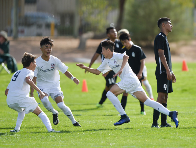 Coronado High School's Alredo Diaz (13), center, celebrates his 1-0 goal with teammates during the first half of the boys Class 4A State Championship at Bettye Wilson Soccer Complex in Las Vegas o ...