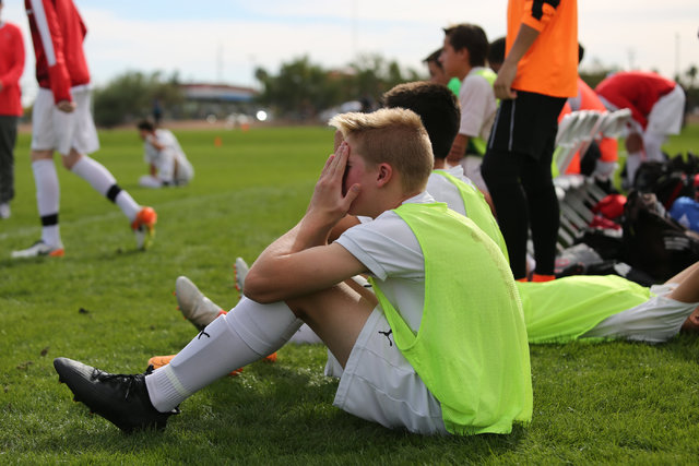 Coronado High School's Brock Rideout (16) covers his face after losing the the boys Class 4A State Championship to Galena High School at Bettye Wilson Soccer Complex in Las Vegas on Saturday, Nov. ...