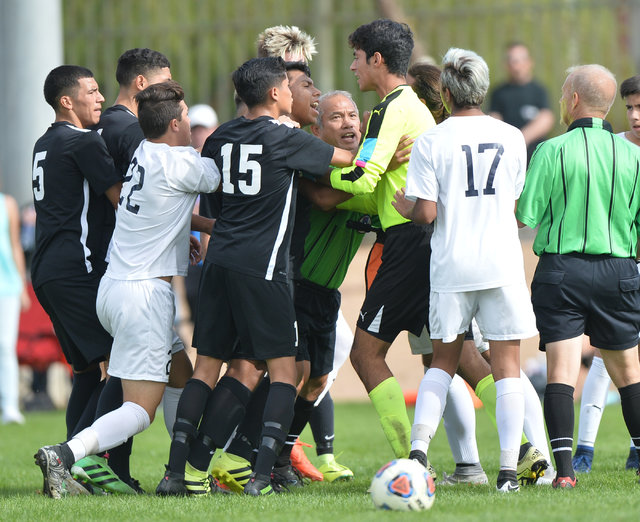Players from Coronado High School and Galena High School get into a shoving match during the boys Class 4A State Championship at Bettye Wilson Soccer Complex in Las Vegas on Saturday, Nov. 12, 201 ...