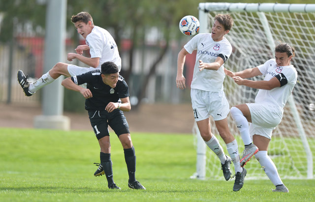 Coronado's Mathew Laudenslager (21) heads the ball during the boys Class 4A State Championship at Bettye Wilson Soccer Complex in Las Vegas on Saturday, Nov. 12, 2016. Brett Le Blanc/Las Vegas Rev ...