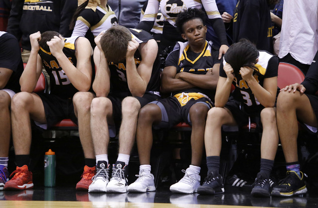 Clark players react after losing to Bishop Gorman in a Class 4A boys state championship final game at the Cox Pavillion on Friday, Feb. 24, 2017, in Las Vegas. Bishop Gorman won 62-58. (Christian  ...