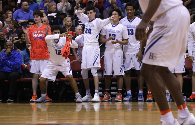 Bishop Gorman players react after one their teammates scores against Clark during the second half of a Class 4A boys state final game at the Cox Pavillion on Friday, Feb. 24, 2017, in Las Vegas. ( ...
