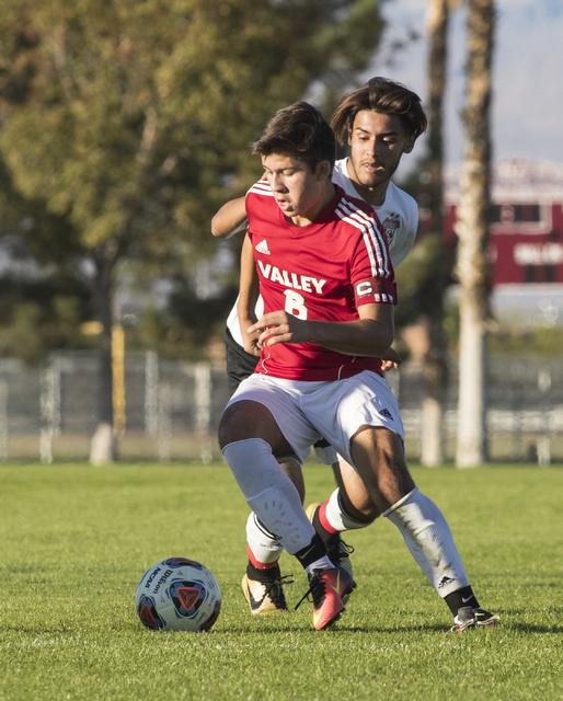 Fausto Vega (6) battles for the ball against Alejandro Graciano (14), from Las Vegas High School, during the Sunrise Region boys soccer semifinal game at Bettye Wilson Soccer Complex in Las Vegas  ...