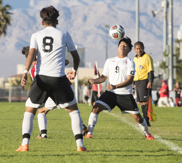 Alejandro RIvera (9), from Las Vegas High School, heads the ball during the Sunrise Region boys soccer semifinal game at Bettye Wilson Soccer Complex in Las Vegas on Thursday, Nov. 3, 2016. Loren  ...