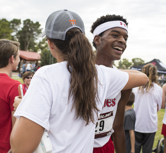 Keith Williams, right, is congratulated by Arbor View's head coach Sheina Torres after the Regional 4A Sunset Boys cross country meet at Craig Ranch Park on Friday, Oct. 27, 2016, in North Las Veg ...