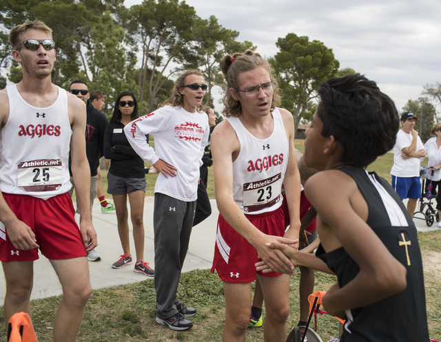 Second place winner Ian Jackson, center congratulates another player while Tim Myers, left, watches after the Regional 4A Sunset Boys cross country meet at Craig Ranch Park on Friday, Oct. 27, 201 ...