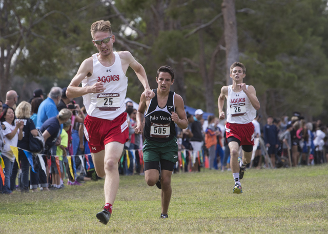 Tim Myers, from left, Evelio Vergara and Andrew Parker race to the finish line during the Regional 4A Sunrise Boys cross country meet at Craig Ranch Park on Friday, Oct. 27, 2016, in North Las Veg ...