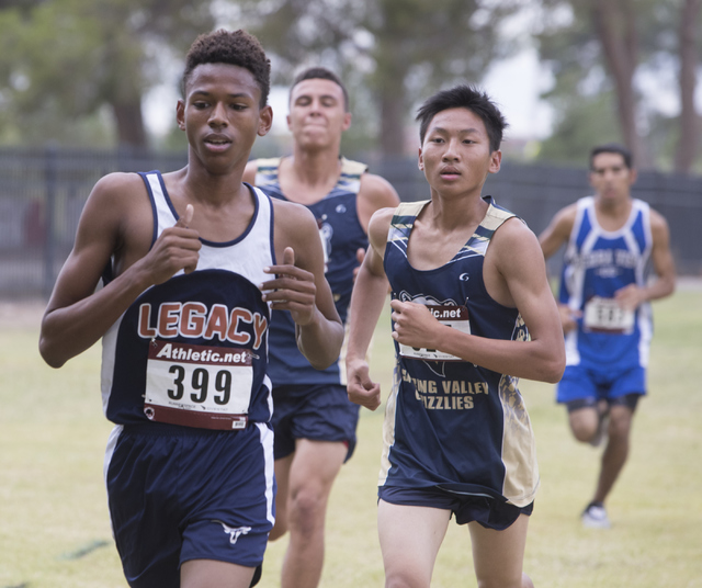 Tylor Vinson, left and William Zheng participate in the Sunset Boys 2016 NIAA Southern Regional cross country meet at Craig Ranch Park on Friday, Oct. 27, 2016, in North Las Vegas. Loren Townsley/ ...