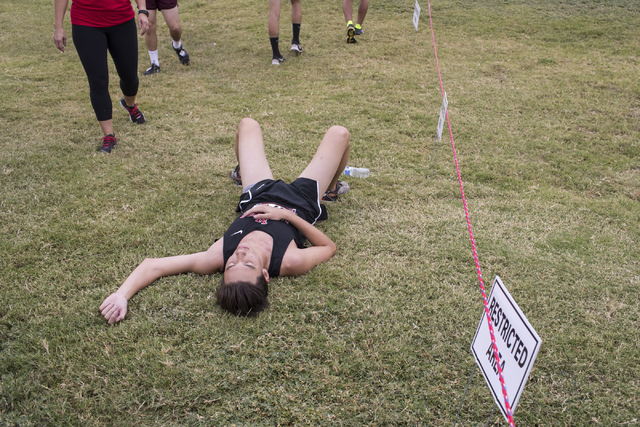 Jason Johnson rests after completing the Sunrise Boys 2016 NIAA Southern Regional cross country meet at Craig Ranch Park on Friday, Oct. 27, 2016, in North Las Vegas. Loren Townsley/Las Vegas Revi ...