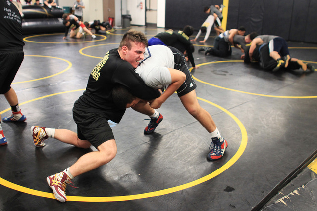 Clark wrestler Jacob Chaparian works out with Edwin Centeno in practice on Tuesday. Chaparian, who finished third at the Division I-A state tournament last season in the 285-pound division, will r ...