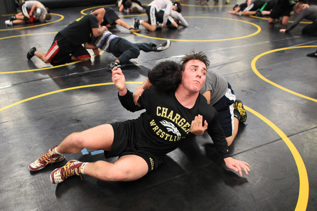 Clark wrestler Jacob Chaparian works out with Damian Garavito in practice on Tuesday. Chaparian, who finished third at the Division I-A state tournament last season in the 285-pound division, will ...