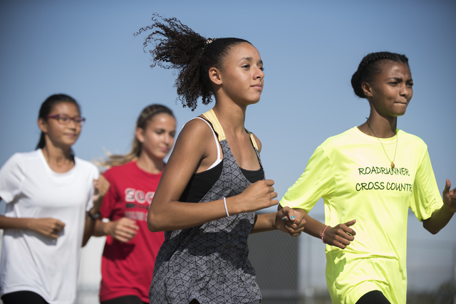 Freshman Diamond Morris, center, 14, runs during cross country practice at Southeast Career Technical Academy on Tuesday, Oct. 25, 2016. Martin S. Fuentes/Las Vegas Review-Journal