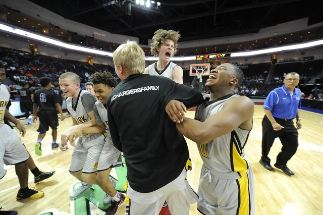 Clark players celebrate their 62-46 win over Desert Pines during the Division I-A boys state championship game at the Orleans Arena in Las Vegas, Saturday, Feb. 28, 2015. (Josh Holmberg/Las Vegas  ...