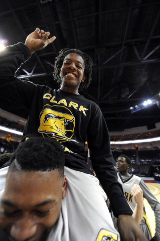 Clark sophomore point guard Nick Davis is hoisted on the shoulders of senior guard Colby Jackson as they celebrate their 62-46 win over Desert Pines during the Division I-A boys state championship ...