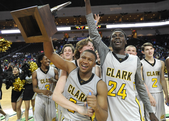 Clark players celebrate their 62-46 win over Desert Pines with the Division I-A state championship trophy  at the Orleans Arena in Las Vegas, Saturday, Feb. 28, 2015. (Josh Holmberg/Las Vegas Revi ...