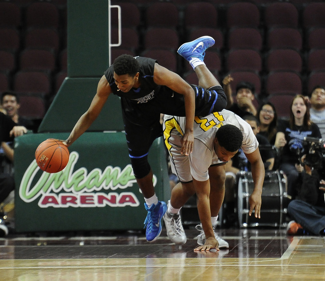 Desert Pines guard Jordan Simon (2) is tripped up by Clark forward Ty'Rek Wells in the first half of the Division I-A boys state championship game at the Orleans Arena in Las Vegas, Saturday, Feb. ...
