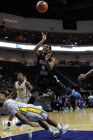Desert Pines guard Jordan Simon (2) is fouled by Clark forward Ty'Rek Wells in the first half of the Division I-A boys state championship game at the Orleans Arena in Las Vegas, Saturday, Feb. 28, ...