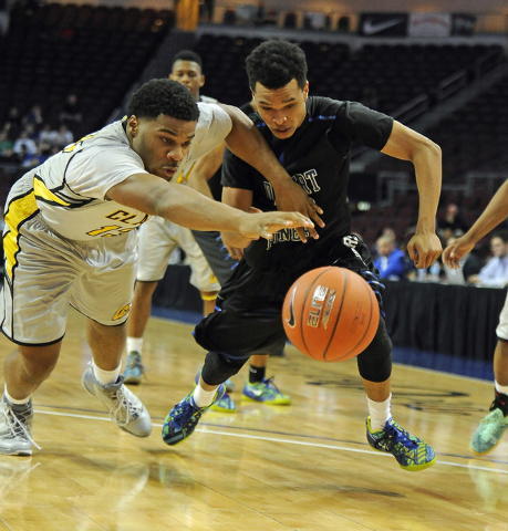 Clark forward Ty'Rek Wells, left, and Desert Pines guard Coby Myles dive for a loose ball in the second half of the Division I-A boys state championship game at the Orleans Arena in Las Vegas, Sat ...