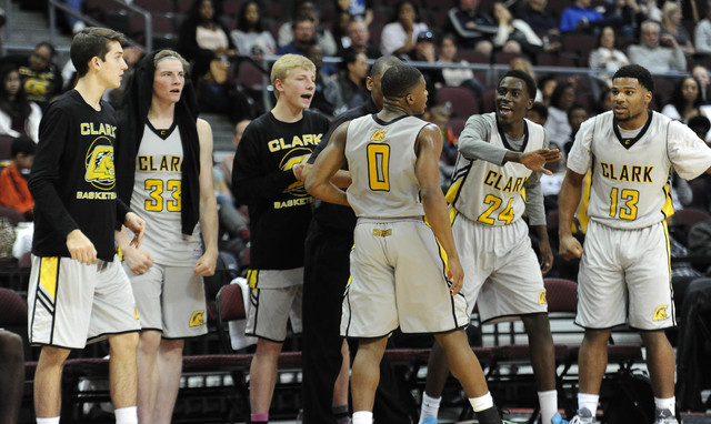 Clark guard Colby Jackson high fives the bench after making a layup despite being fouled by Desert Pines guard Jordan Simon (2) the Division I-A boys state championship game at the Orleans Arena i ...