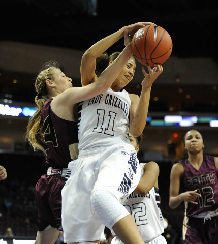 Spring Valley guard Kayla Harris (11) grabs a defensive rebound against Faith Lutheran forward Morgan Hill in the first half of the Division I-A girls state championship game at the Orleans Arena  ...