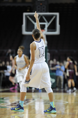 Spring Valley guard Kayla Harris (11) signals points after assisting on a fast-break basket against Faith Lutheran in the first half of the Division I-A girls state championship game at the Orlean ...