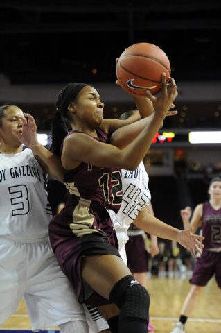 Faith Lutheran guard Haley Vinson (12) grabs a rebound in front of Spring Valley guards Essence Booker (3) and Myra Tadytin (42) in the first half of the Division I-A girls state championship game ...