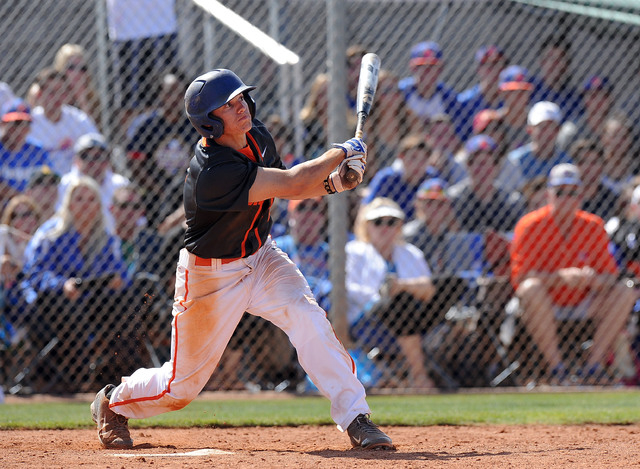 Bishop Gorman shortstop Cadyn Grenier (2) hits a walk-off home run against Green Valley in the ninth inning of the NIAA Division 1 State championship baseball game at Durango High School in Las Ve ...