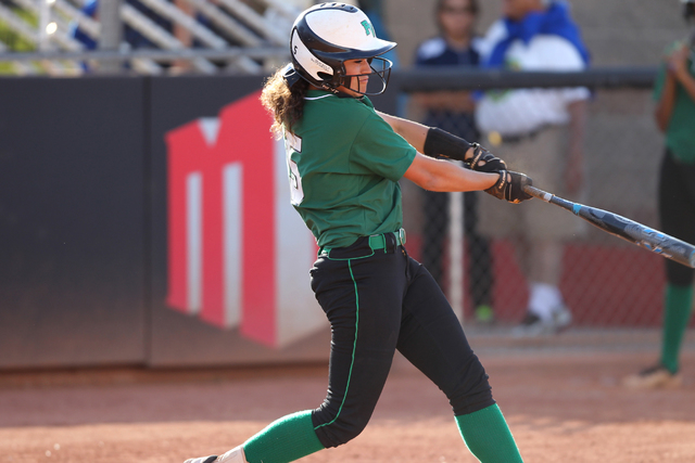 Palo Verde's Cara Beatty (5) swings the bat for a home run in the second inning of their softball game against Rancho at Eller Media Softball Stadium at UNLV in Las Vegas Thursday, May 14, 2015. P ...