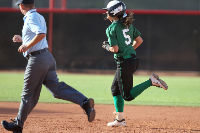 Palo Verde's Cara Beatty (5) runs the bases after a solo home run in the second inning of their softball game against Rancho at Eller Media Softball Stadium at UNLV in Las Vegas Thursday, May 14,  ...