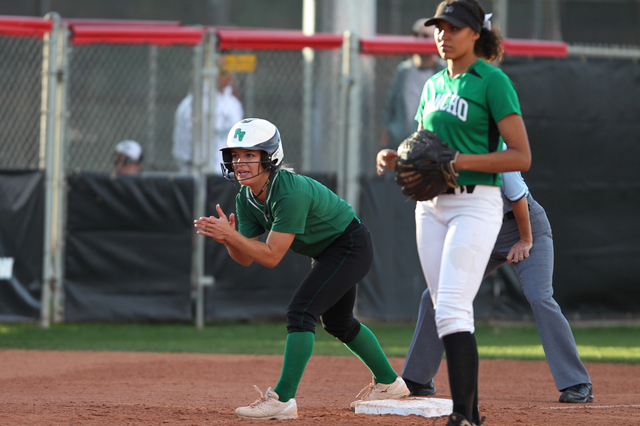 Palo Verde's Jordan Menke (7) cheers her teammate from third base in the fifth inning of their softball game against Rancho at Eller Media Softball Stadium at UNLV in Las Vegas Thursday, May 14, 2 ...