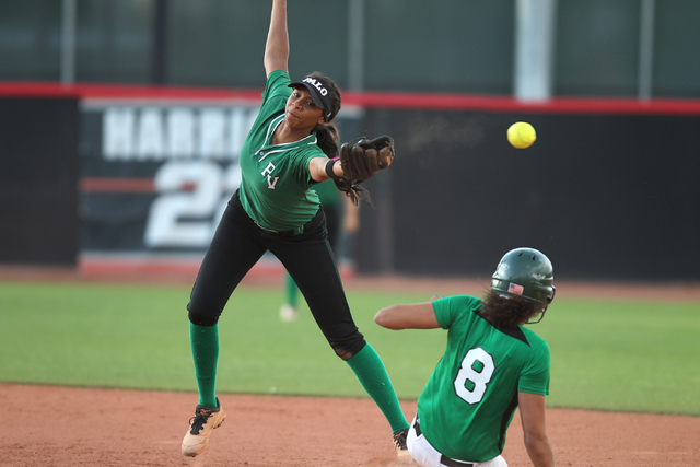 Palo Verde's Nae Gage (2) misses a catch at second base in the sixth inning to let Rancho's Kayla Coles slide safely in their softball game at Eller Media Softball Stadium at UNLV in Las Vegas Thu ...