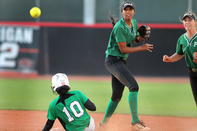 Palo Verde's Nae Gage (2) throws late to first base after getting an out at second in the sixth inning of their softball game against Rancho at Eller Media Softball Stadium at UNLV in Las Vegas Th ...