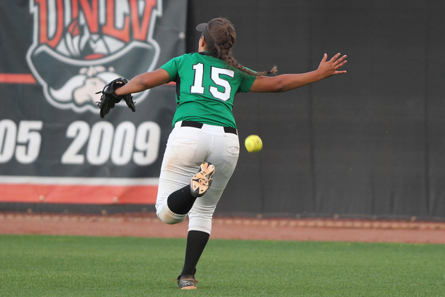 Rancho's Yvette Sanchez (15) is short of a catch to let the winning run score by Palo Verde in their softball game at Eller Media Softball Stadium at UNLV in Las Vegas Thursday, May 14, 2015. Palo ...