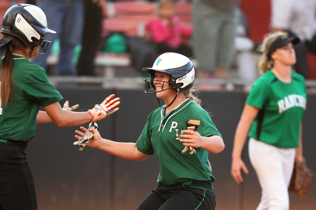 Palo Verde's Lo Oxford (10), right, opens her arms as she scores the winning run to embrace her teammate Kiley Harrison (11) in their softball game against Rancho at Eller Media Softball Stadium a ...