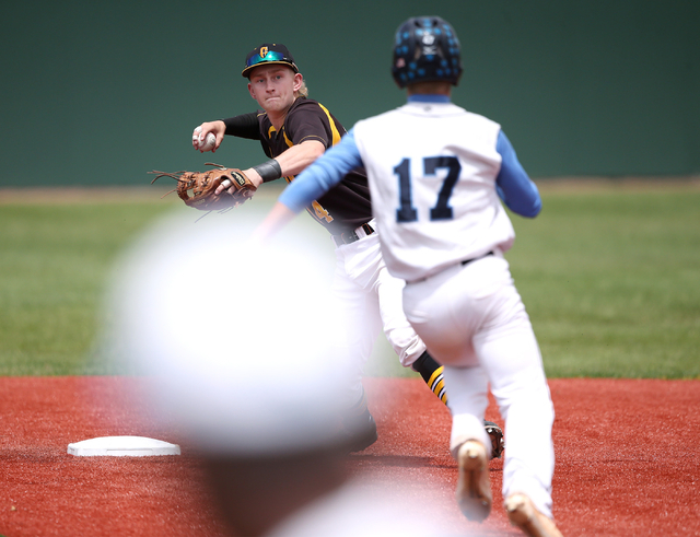 Galena's Parker Kittilsen turns a double play against Centennial's Austin Kryszcuk during NIAA DI baseball action at Bishop Manogue High School in Reno on Thursday, May 19, 2016. Galena won 4-2. C ...