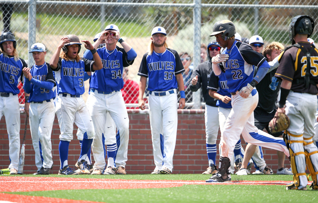 basic teammates celebrate after jj smiths home run against galena during niaa di baseball action at