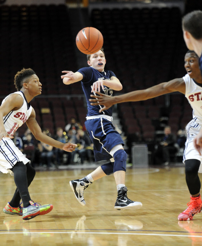 The Meadows School guard Ethan Fridman passes as Agassi Prep guard Deishaun Booker, left, and Kobe Williams, right, defend in the first quarter of the Division III boys state championship game at  ...