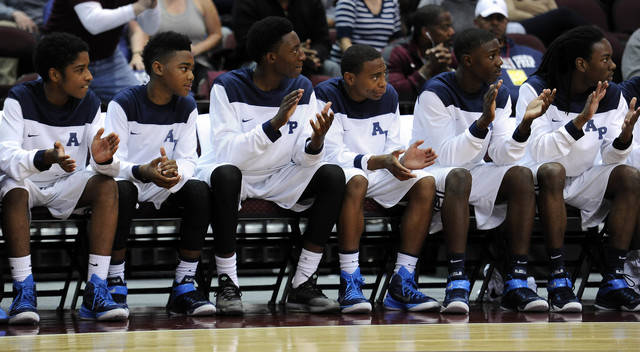 The Agassi Prep bench claps after a foul is called against The Meadows School in the first quarter of the Division III boys state championship game at the Orleans Arena in Las Vegas, Saturday, Feb ...