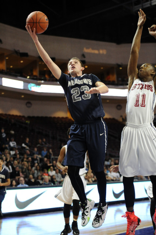 The Meadows School guard Jake Epstein (23) makes a layup against Agassi Prep guard Deishaun Booker (11) in the first quarter of the Division III boys state championship game at the Orleans Arena i ...