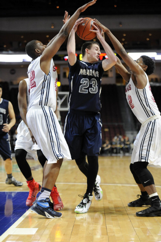 The Meadows School guard Jake Epstein (23) is surrounded byAgassi Prep forward Darius Coaxm, left, and guard Kenneth Hatano in the first quarter of the Division III boys state championship game at ...