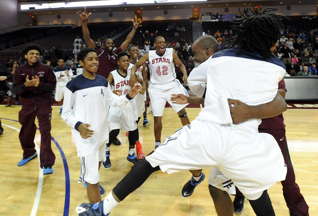 Agassi Prep players celebrate their win over The Meadows School in the Division III boys state championship game at the Orleans Arena in Las Vegas, Saturday, Feb. 28, 2015. (Josh Holmberg/Las Vega ...