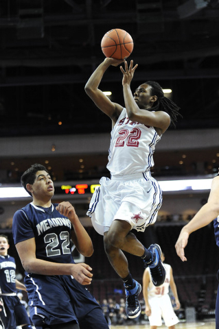 Agassi Prep forward Jordan Smith (22) is fouled by The Meadows School center Max Hisatake in the fourth quarter of the Division III boys state championship game at the Orleans Arena in Las Vegas,  ...