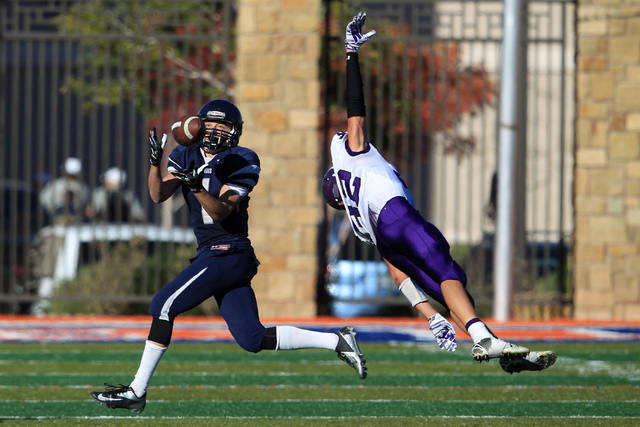 The Meadows' wide receiver Ethan Fridman pulls in a pass under coverage by Yerington linebacker Reese Neville during their Division III championship game Saturday. Fridman caught seven passes for  ...