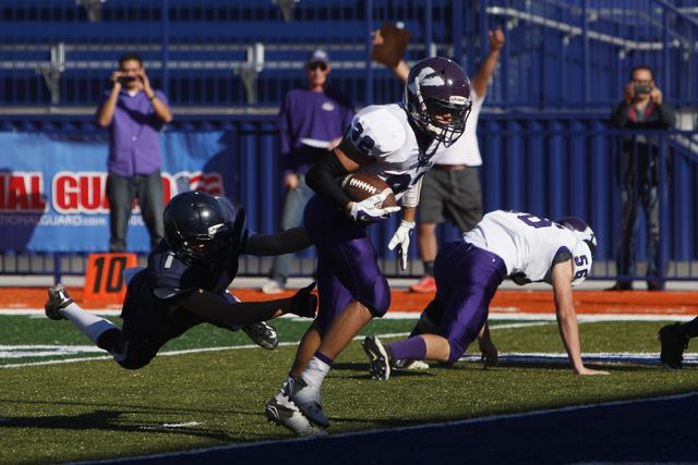 Yerington wide receiver Reese Neville gets past The Meadows defensive back Ethan Fridman and into the end zone for a score during their Division III championship game Saturday. Neville ran for fou ...