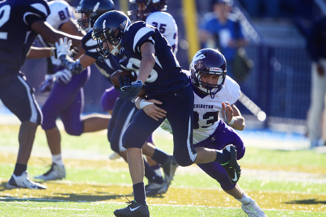 Yerington linebacker Harrison Cisneros brings down The Meadows returner Adam Martinez on a kickoff during their Division III championship game Saturday. Yerington won the game 45-14. (Sam Morris/L ...